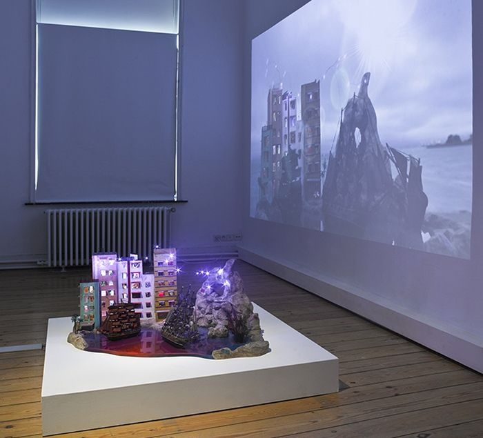 The Island, 2013, Wood, paint, lights, ships, fake landscaping and water, lcd screen, media player, speakers, transformer, video projection, 45 x 108 x 61 cm, unique