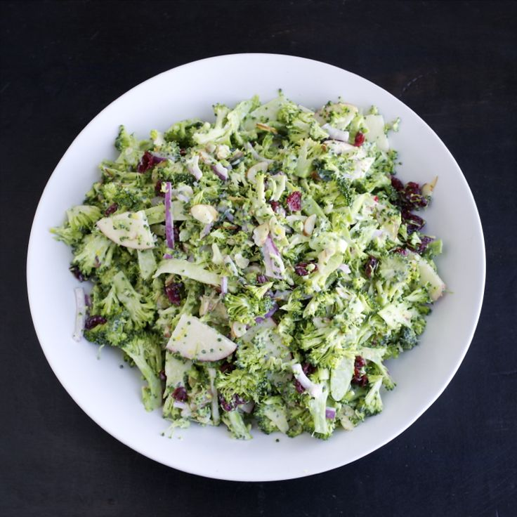 Shaved Broccoli Salad ~ crisp, crunchy slivers of broccoli, surrounded by a light and creamy dressing and flecked with sweet cranberries, tart apple slices and nutty almonds.  The added bonus?  It's very low in fat!  :)