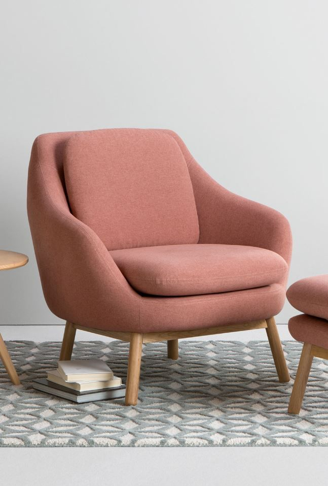 Oslo accent chair, £449 MADE.COM Upholstered in a Dusk Pink fabric, this charming chair adds character to a living space. It's great looking, and its Velcro cushions are practical too.