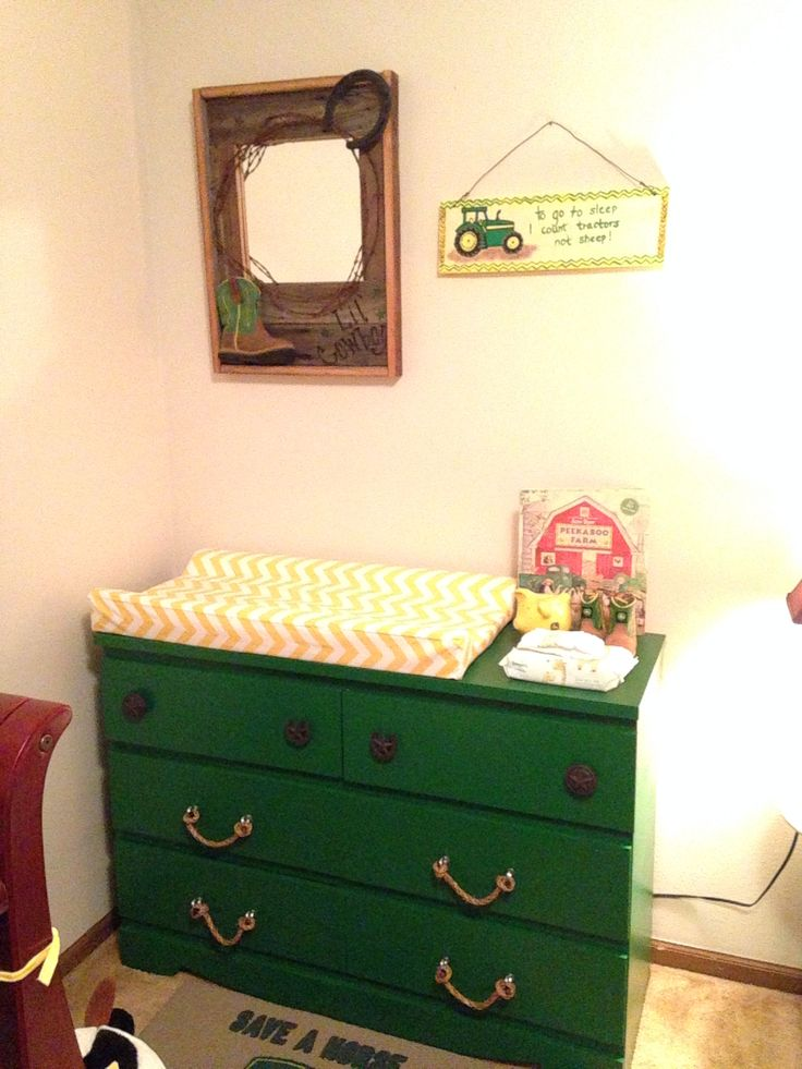 My sons John Deere nursery! My grandpas dresser painted john deere green, homeade rope pulls & other cute DIY stuff. :)