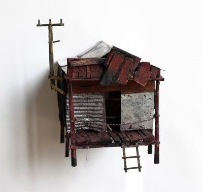 The artist known as Demiak ( Maarten Demmink) makes small sculptures of dilapidated houses from reclaimed materials including wood and tin.