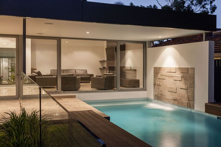 Pool and water feature flow effortlessly off the living area.  Designed by Urbane Projects, Perth.