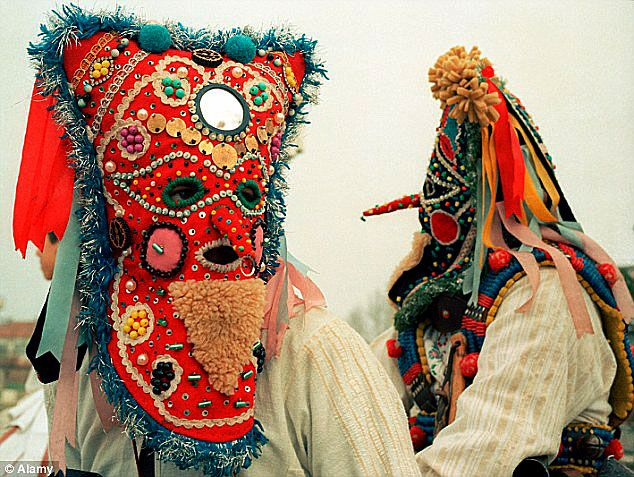 Kukeri Folk mask, Bulgaria  fur, fabric with ribbons, beads, metal and sequins. In March, Kukeri dressed in masks and animal costumes to drive away evil spirits with sticks and bells. Here are two very colorful examples from the big celebration.