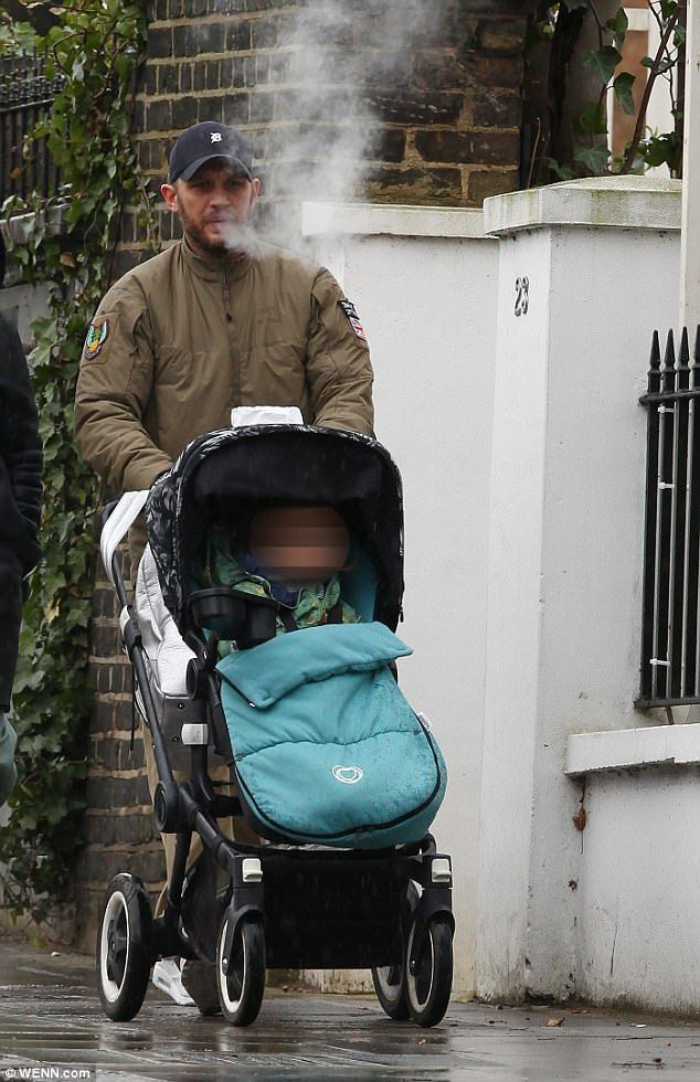 757d5eea9 Tom Hardy braves the wet weather with wife Charlotte Riley | Tom ...