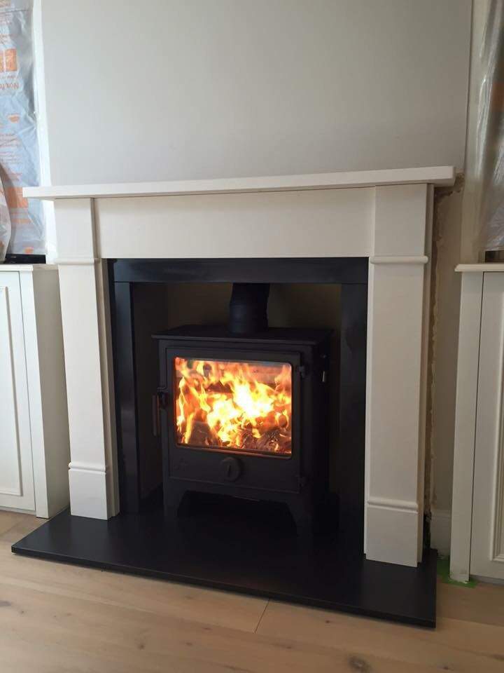 Dean forge Dartmoor W5 wood burning stove with limestone surround.