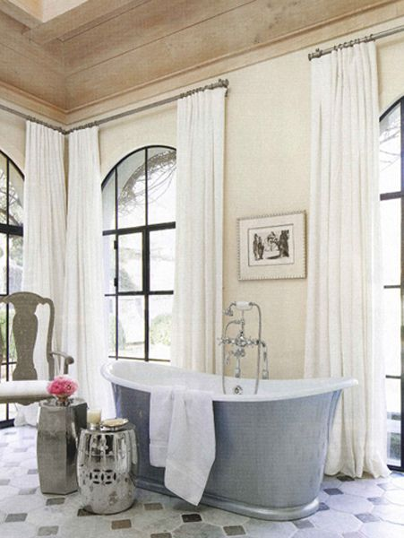 The Waterworks Candide bathtub and two barrel stools unify as one elegant piece of sculpture in this bath by @Beth Webb