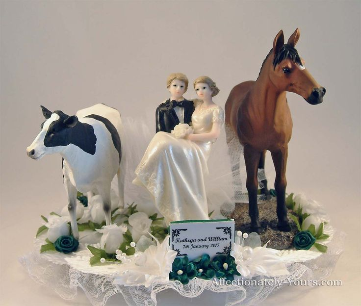 This customized Romance Acres wedding cake topper with dark blonde bride | groom, holstein cow and bay horse is shown in ivory with hunter green accents.  Includes personalized plate for names and wedding date.  https://www.affectionately-yours.com/romance-acres-bride-groom-horses-farm-animals-wedding-cake-topper/