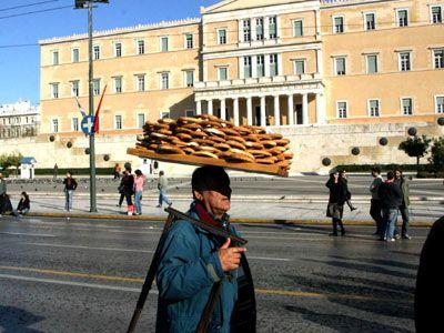 "bagel vendor ""koulouras"" in front of Greek Parliament House #solebike e-bike tours,"