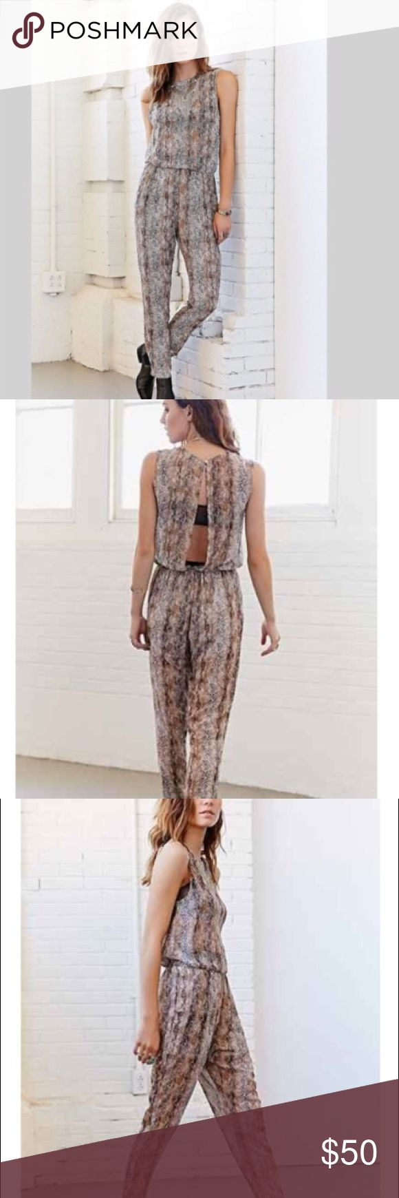 "ECOTE ~ UO brown snake print sheer jumpsuit size S ECOTE ~   ECOTE brand  From urban outfitters  Size small  New with tags attached  Brown color  Snake print pattern  Jumpsuit  Open back jumpsuit  Brown jumpsuit  Animal print jumpsuit  Sheer fabric  Front pleated waist  Elastic waist in back  Tapered legs  Side pockets  Bottom lined  Sheer top  Polyester fabric  Made in China   Flat measurements:  Length waist to hem 40"" Waist unstretched 14"" Bust 17"" Ecote Pants Jumpsuits & Rompers"