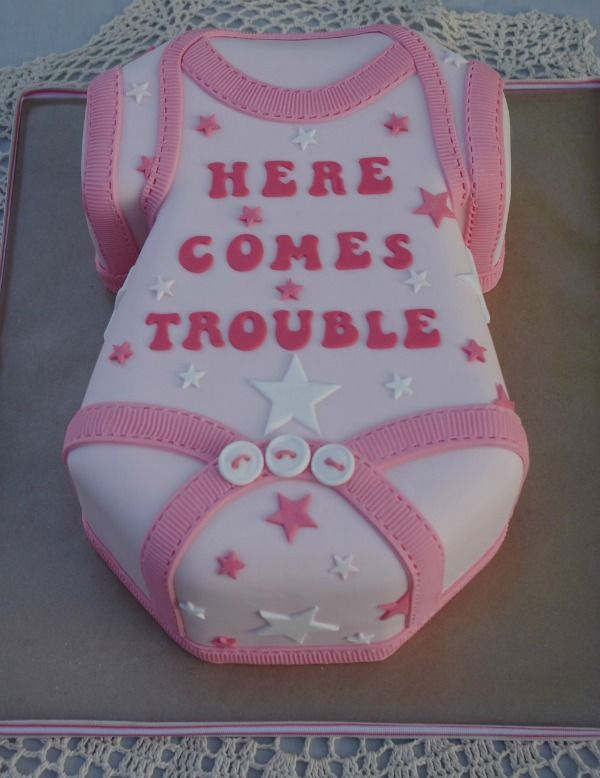 Pink Onesie #Baby #Shower #Cake by Munchin cakes.  Click to see more classic baby shower cakes.