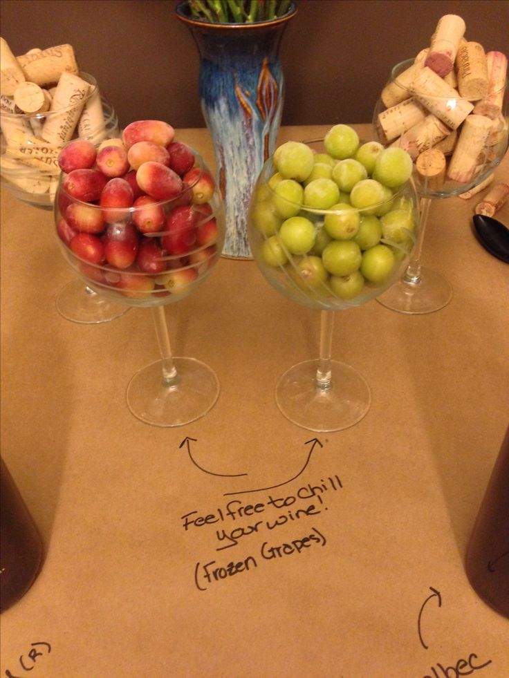 Wine and appetizer potluck - frozen grapes as ice cubes for drinks :) {wineglasswriter.com/}
