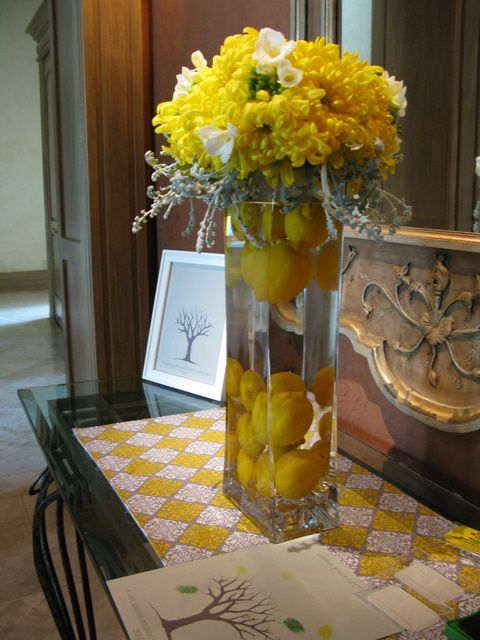 Use lemons (whole or cut) in tall vase. May fill completely or add white flowers on top.#Repin By:Pinterest++ for iPad# @Jennifer Silveri