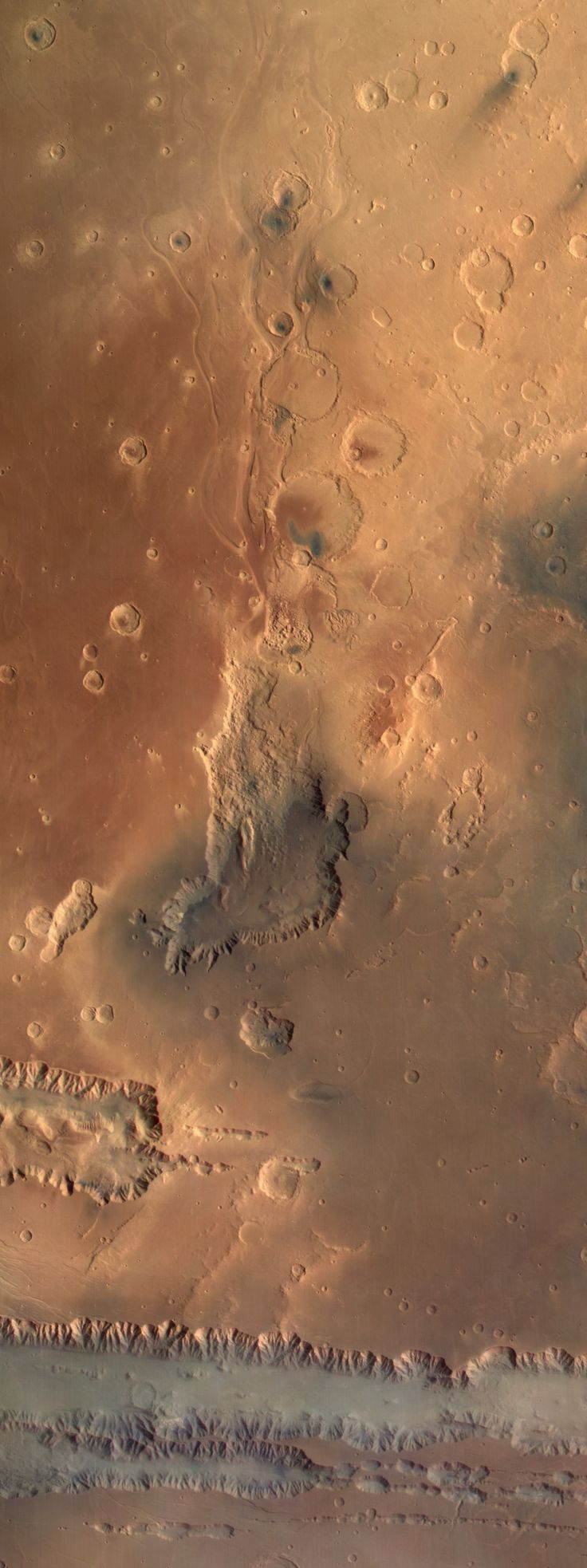 The Mars Express orbiter captured this striking view of rugged Martian landscapes extending from a mist-filled Coprates Chasma in the south, to Juventae Chasma and the outflow channels of Maja Valles in the north. Juventae Chasma, the box canyon near the center of the image, is about 100 km wide.
