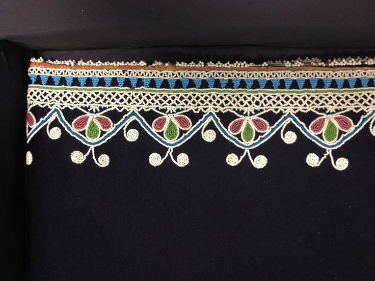 Detail of Caroline Parker's beaded wool skirt. ca. 1850. Conserved at Spicer Art Conservation. Collection of NYS Museum.