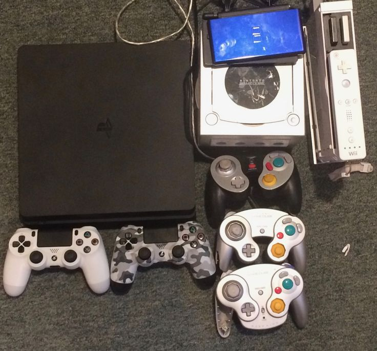 My new PS4 to my old Nintendo Gamecube, Nintendo DS, and Nintendo Wii along with controllers.
