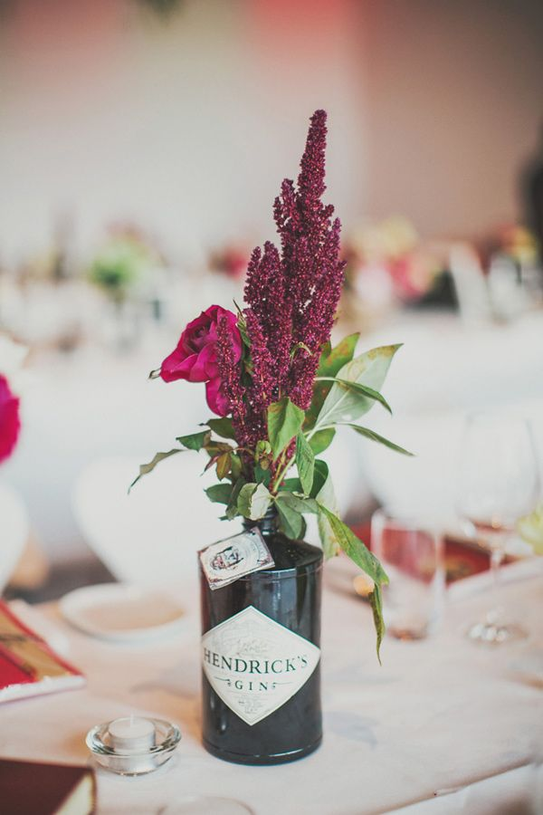 fantastic use of a Hendrick's gin bottle, photo by Ben Adams http://ruffledblog.com/sydney-museum-of-contemporary-art-wedding #centerpieces #reception #weddingideas