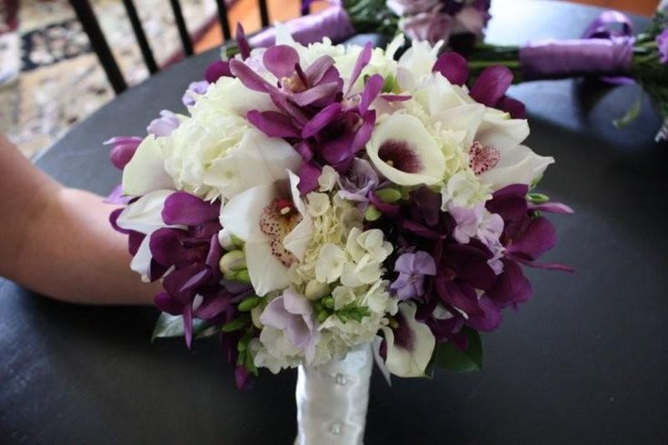 We used white Cymbidium Orchids, purple Mokara Orchids, lav Freesia, white Hydrangea, white mini calla's with a purple center and lav Phlox. The bouquet was simply stunning.