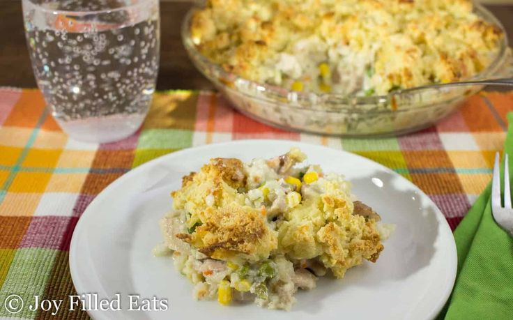 My Low Carb Chicken Pot Pie is comfort food at it's finest. It is full of vegetables, chicken, a rich creamy sauce, and then topped with a cheesy biscuit.
