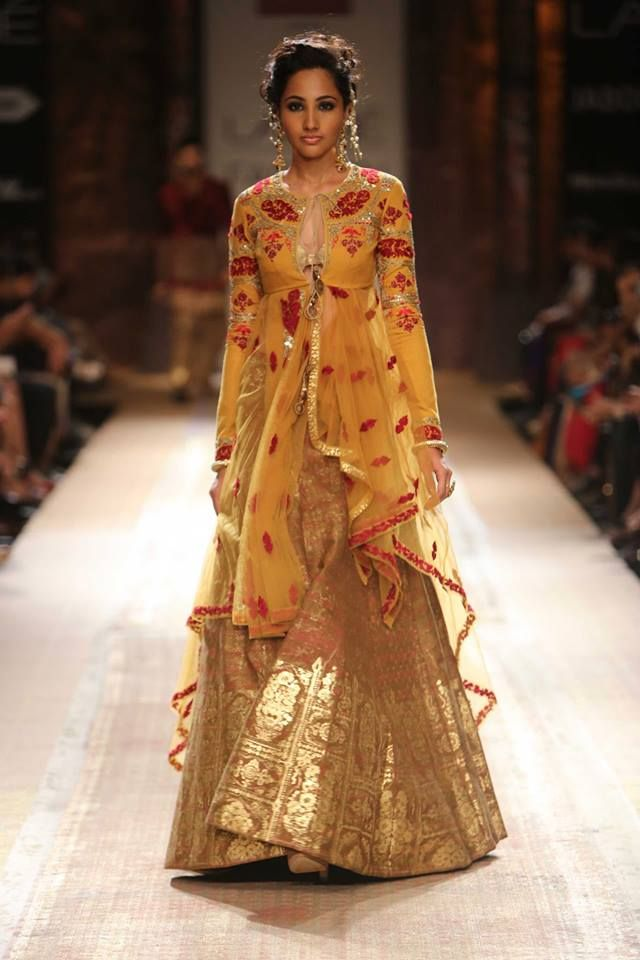 Orange mustard yellow sheer jacket lehenga by Anju Modi at Lakme Fashion Week Winter 2014. More here: http://www.indianweddingsite.com/lakme-fashion-week-winter-2014-anju-modi-collection/