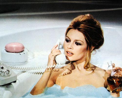 Brigitte bardot 8x10 photo on old telephone in bath tub holding perfume