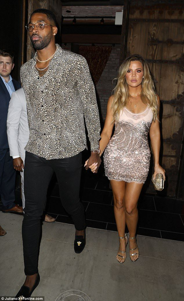 In the spotlight: She turns 33 on Tuesday but on Sunday night Khoe Kardashian celebrated her birthday early on the arm of NBA beau Tristan Thompson in Hollywood