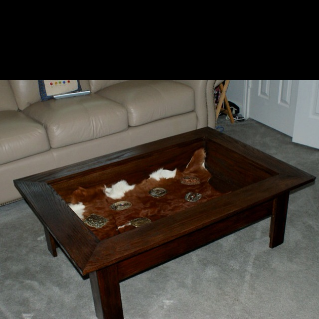 oak table with glass shadow box used for buckles trophies holiday decor books