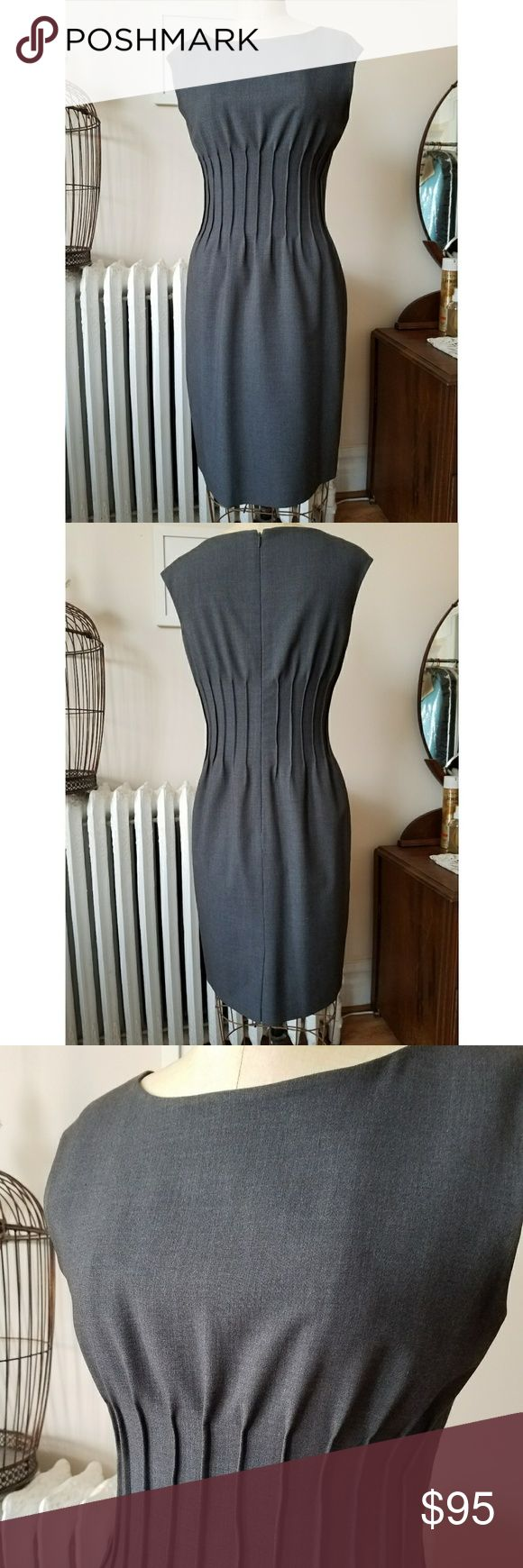 """Calvin Klein Grey Work Dress with Pintuck Details Super smart and sophisticated. This dress takes you from the boardroom to after work drinks with the change of jewelry. Lightweight rayon blend looks like grey flannel. Fully lined. Pintucks give you a flattering shape! Size 6. Terrific condition. Bust=36"""" waist=30"""" Hip=39/40"""" Calvin Klein Dresses Midi"""