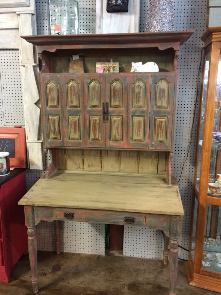 """Just finished """"Magie"""" a desk with hutch. Painted in CeCe Caldwell's Paints cinco bayou moss, dry brushed with Thomasville teal, and pueblo pepper. Distressed, waxed and buffed!!"""