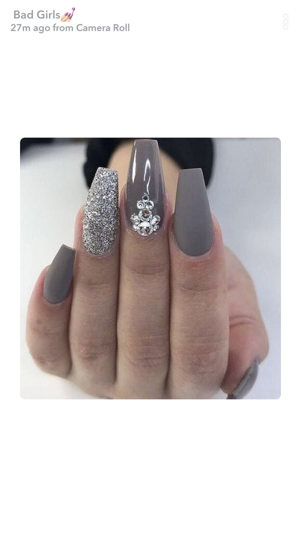 Fancy grey nails.