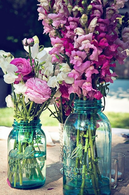 love the flowers and the mason jars as centerpieces (but not the color)