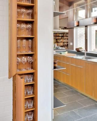 Carve out cabinets in unexpected place  Turn narrow columns of bare wall into useful storage by creating custom cabinets to fit.  And remember, if there's only room for really shallow cabinets, use them for special-occasion stemware that breaks easily.