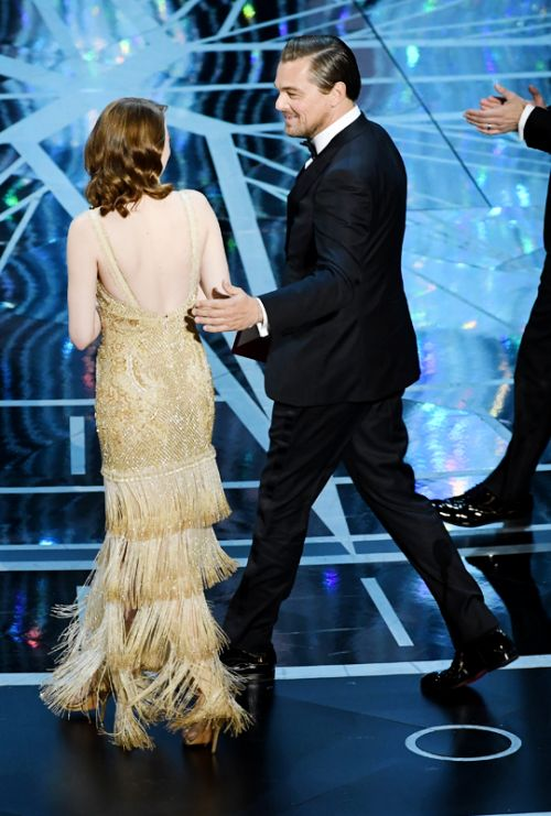 Emma Stone accepts Best Actress for 'La La Land' from actor Leonardo DiCaprio onstage during the 89th Annual Academy Awards at Hollywood & Highland Center on February 26, 2017 in Hollywood, California.