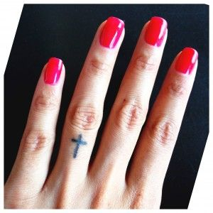 Small cross tattoo on my ring finger. Jesus is my first love.