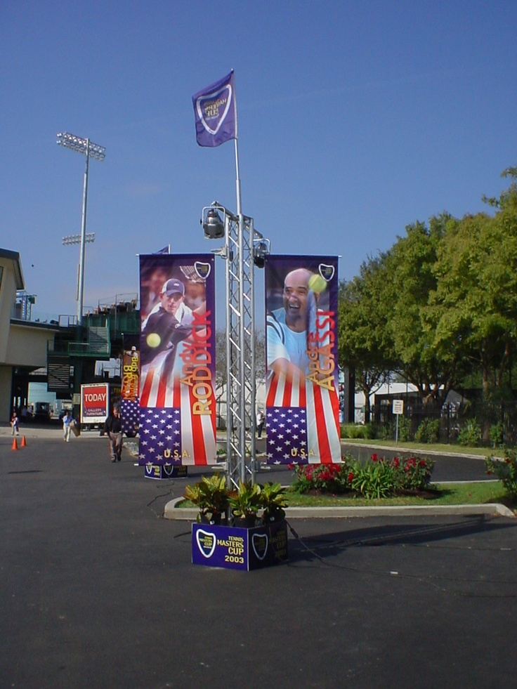 Colorful shot of our light pole banners installed using BannerSaver™ brackets.