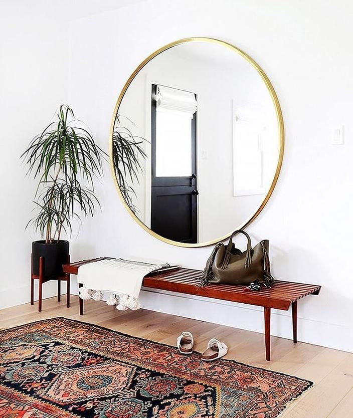 This huge round mirror is the perfect addition to your entryway or hallway. Paired with a teak wood bench & bamboo plant, this mirror slays!