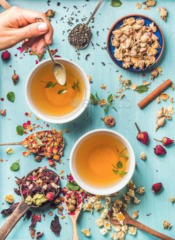 Two cups of healthy herbal tea with mint, cinnamon, dried rose