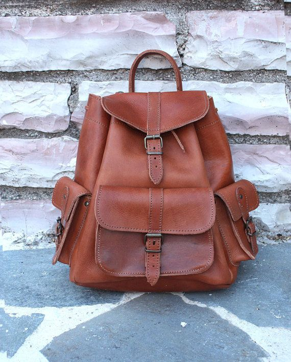 Leather backpack 3 pocket backpocket with zipper by SANDALIANAS, $98.00 Can't fit a laptop, but super cute!