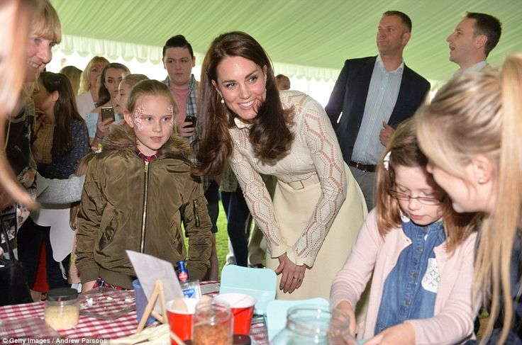 The Duchess wore a cream lacy dress by Chloe, which she also wore during her tour of Canad...