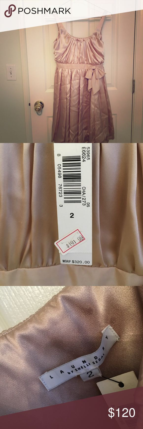 Gold Laundry dress NWOT Gorgeous gold silk dress. NWOT. Was folded in closet so would need to be dry cleaned but otherwise in perfect condition. Super flattering cut - lightly skims the body. Laundry by Shelli Segal Dresses