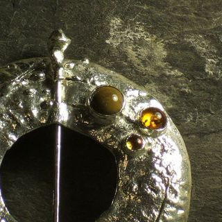 Amber petrified wood and citrine pin made by Roche Designs
