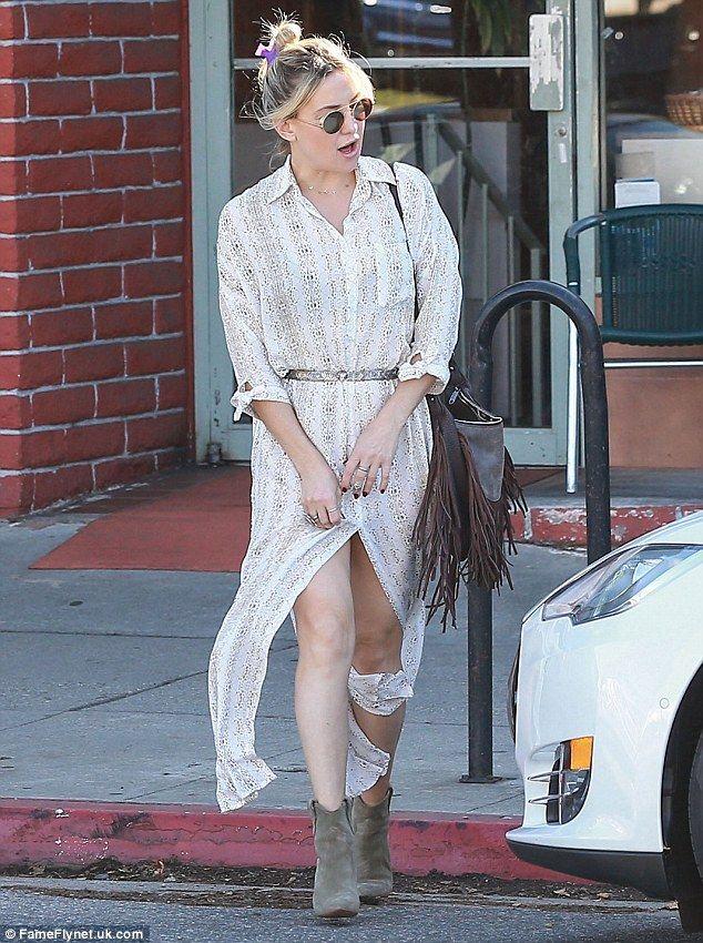 Leggy blonde! Kate Hudson nearly suffered a wardrobe malfunction in a high-cut dress as sh...