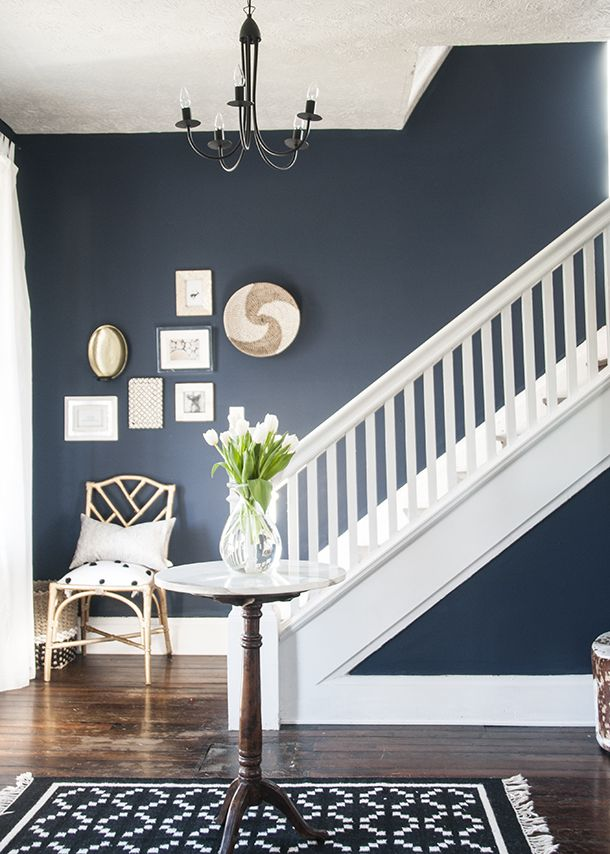 Beautiful navy entryway: paint is Sherwin Williams Naval, part of the Pottery Barn Collection