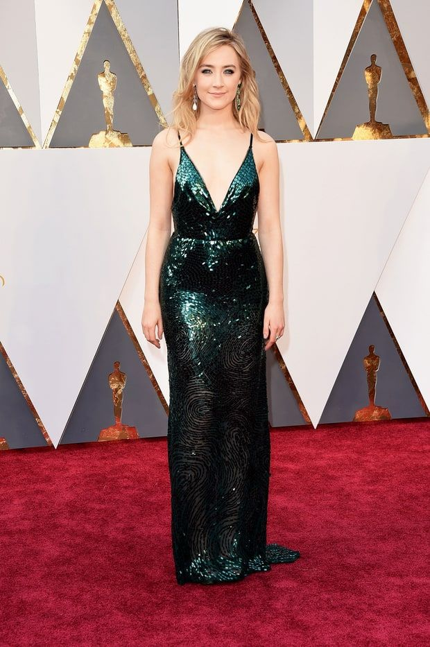 Saoirse Ronan | Oscars 2016  The Brooklyn actress wowed in a plunging green dress by Calvin Klein Collection that featured a low back and swirling beaded designs on the skirt. She finished with intentionally mismatched Chopard earrings.