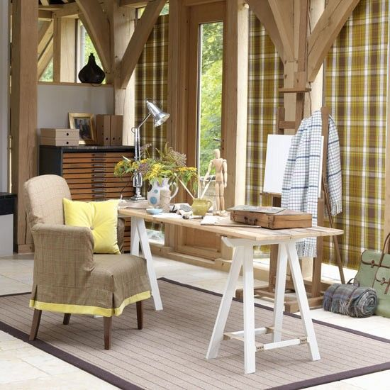 Highland-inspired home office  Create a cosy Highland hideaway home office with colours inspired by the Scottish landscape. Pale natural woods and simple plaid fabrics give a modern twist to this classic country-style study. Tartan panels make a great alternative window treatment and a trestle craft table completes the rustic look.