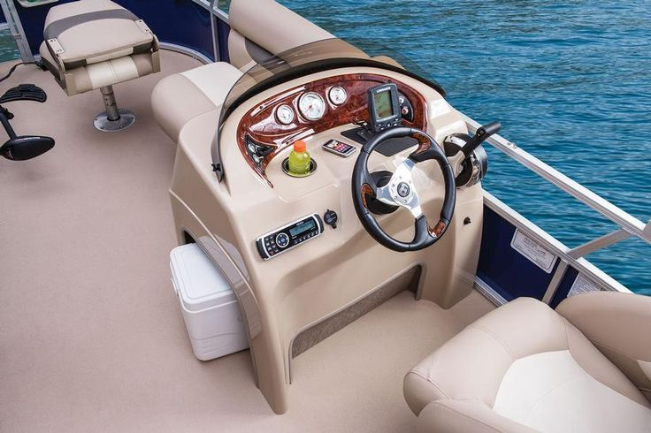 Below-console storage space, moulded fibreglass-reinforced console w/removable tinted windscreen, padded small items storage shelf, drink holder, sport steering wheel w/simulated burlwood accents http://www.exclusiveautomarine.com/product/fishin-barge-20-dlx