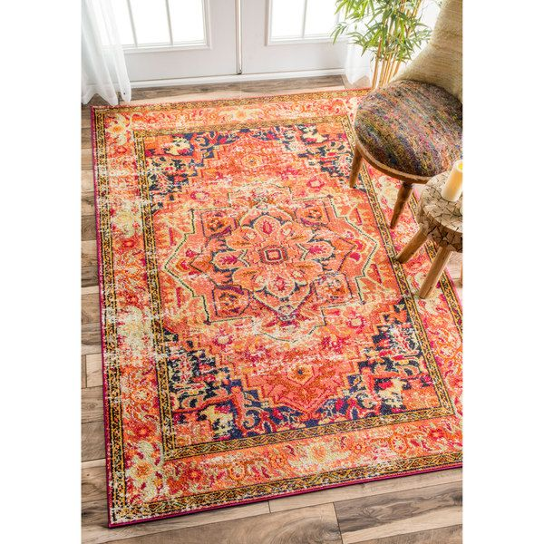 This area rug is crafted with easy-to-clean yarns that prevents shedding, unlike wool. The rug features a variety of modern shades that will enhance your decorative scheme. Pile Height: 0.25 - 0.5 inc
