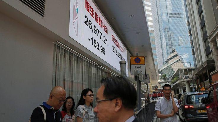 Asian shares slide as Wall St tech swoon weighs on sentiment #Business_ #iNewsPhoto