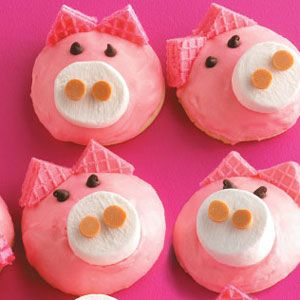 Pig Cookies...   sugar cookie... vanilla frosting + a little bit of red food coloring to make it pink...marshmellow...chocolate chips...pink cookie ears...butterscotch chips
