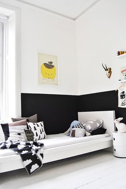 Very contemporary black and white kids room, complete with half black wall. | amerrymishapblog.com