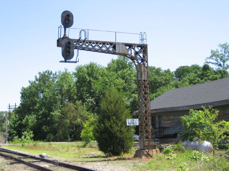 Cantilever Signal Bridge. One detail that screams C&O is this distinctive cantilever signal bridge. This particular example stands in Gordonsville, though they were used across the system. These signal bridges were used over both single and double tracks.